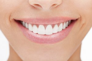 For veneers, schedule a visit with Farmington cosmetic dentist Dr. Thomas Peters.