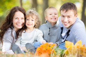 family with beautiful smiles thanks to their trusted family dentist in farmington
