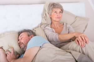 woman upset with husband snoring